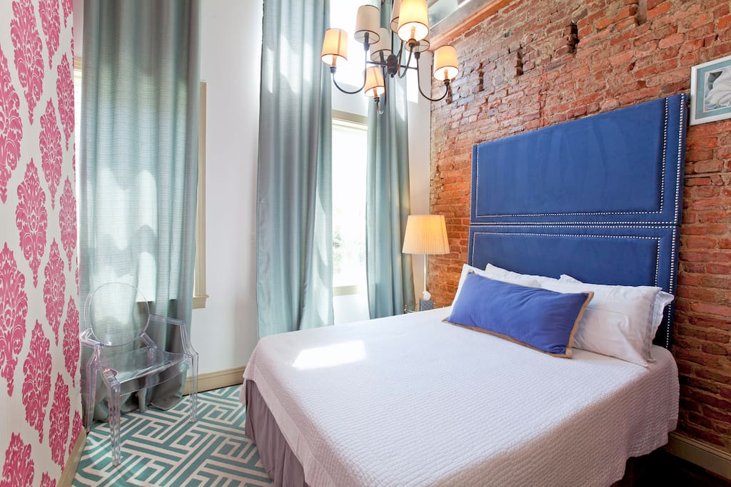 Master suite.  Exposed brick, really high ceilings and lots of light pouring into the room.  You will oversleep in Tempurpedic bed