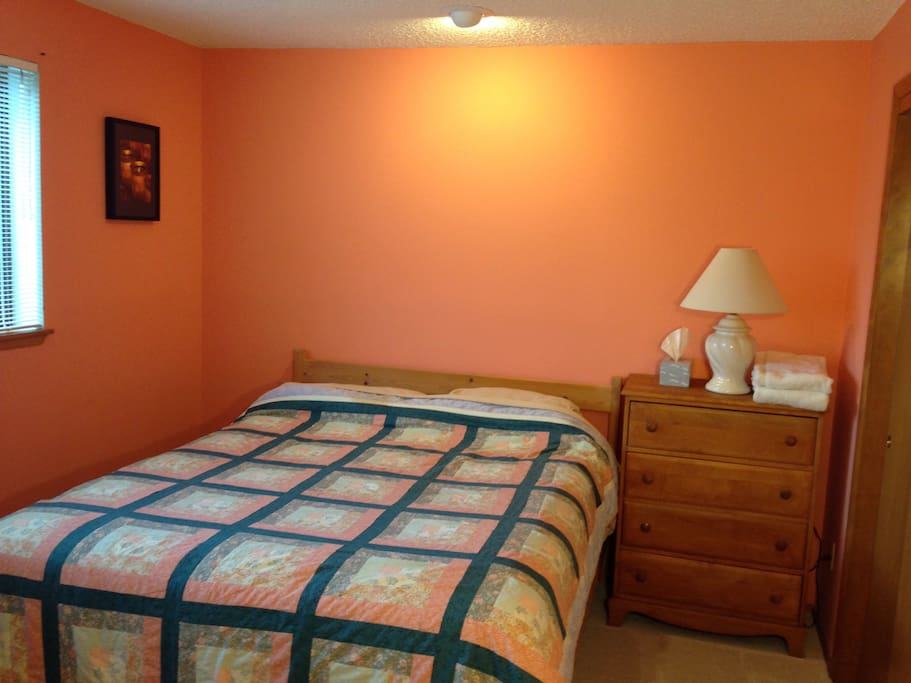 Coral bedroom features queen sized bed and twin bed