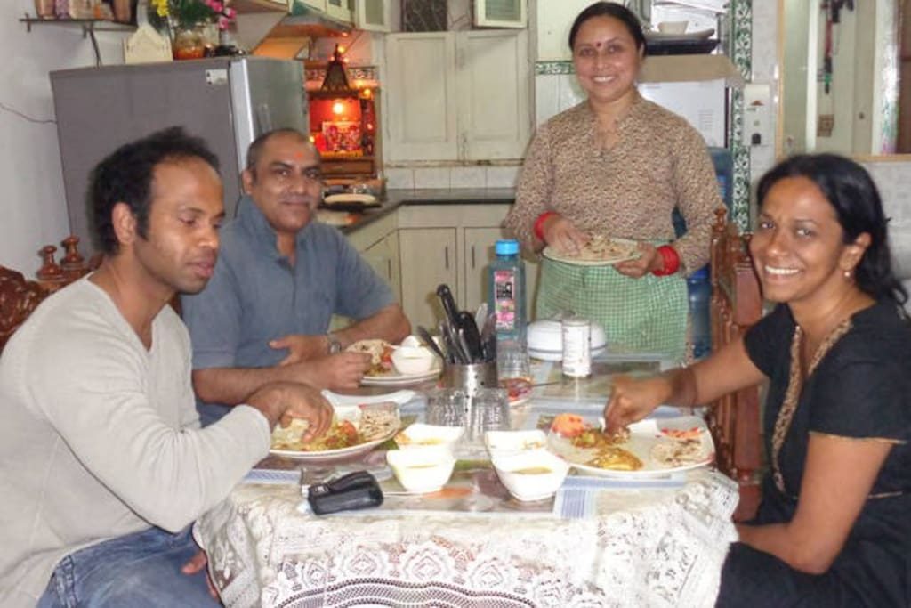 guests enjoying homemade Indian meal!