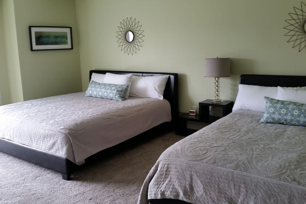 Bedroom features one king bed and one queen bed