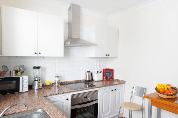 Kitchen. It has all the necessary appliances.