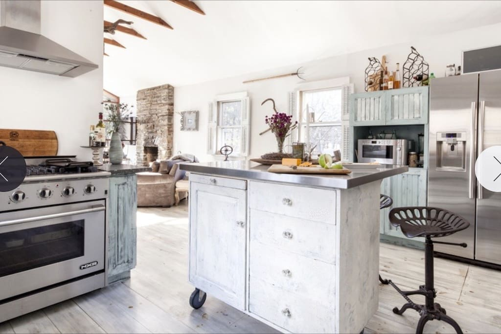 open kitchen - shabby chic with modern high end appliances
