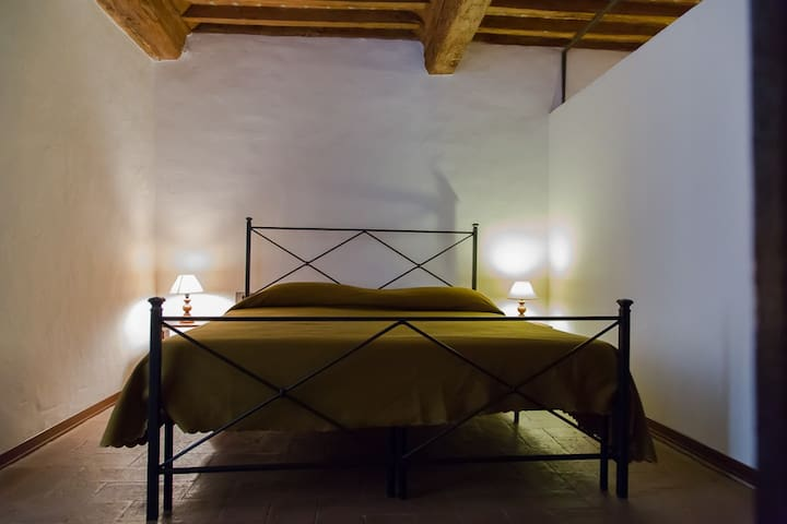One of the two bedrooms with views of the church of Sant' Agostino (the rooms are identical to each other and as a provision such as square footage)