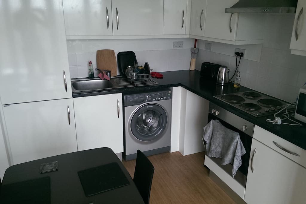 Modern kitchen area with fridge/freezer