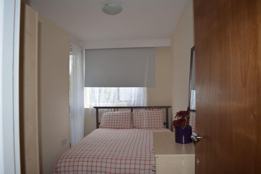 Small bright and cosy room with a double bed