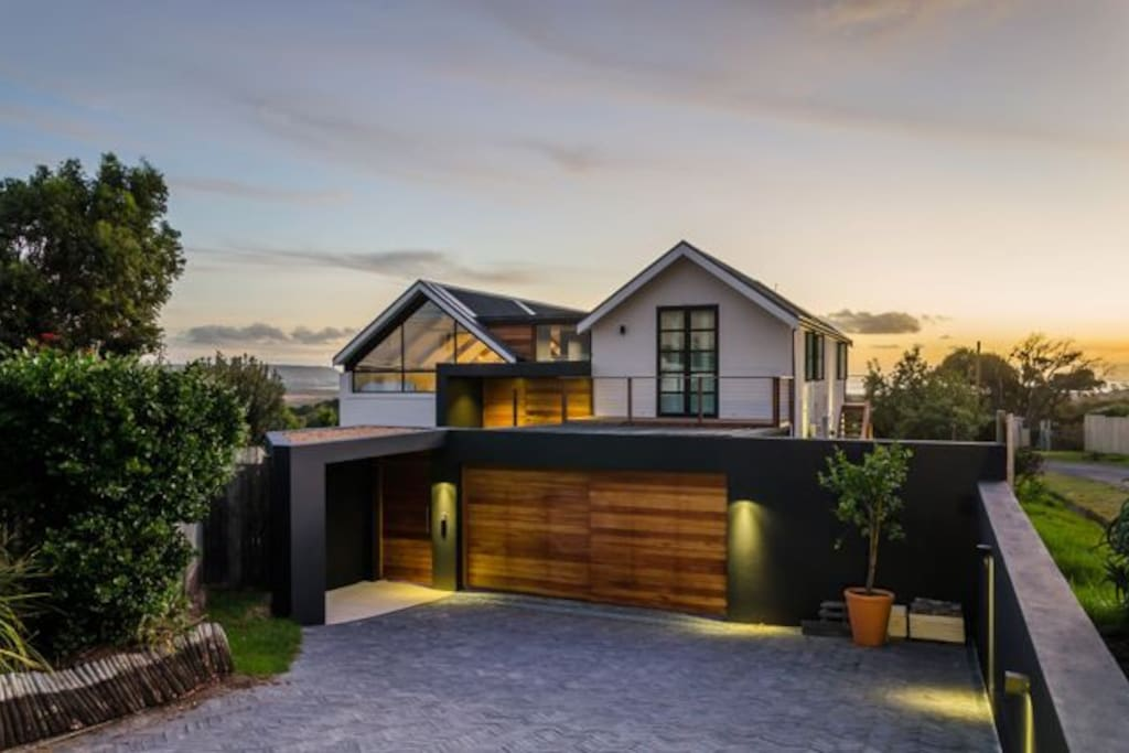 The home from the front by dusk. Double garage and a seperate entrance with security intercom system