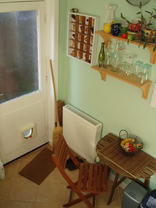 The shared kitchen has a small breakfast table