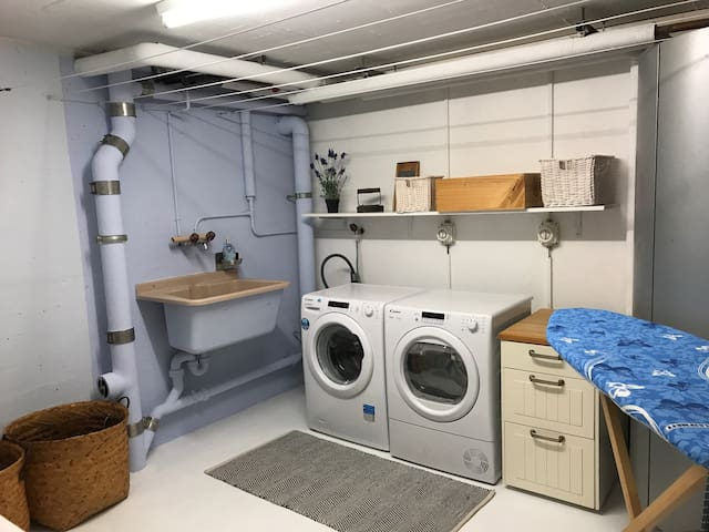 Spaceous laundry room and ironing facilities. An extra shower is also available for when there is a fulll house.