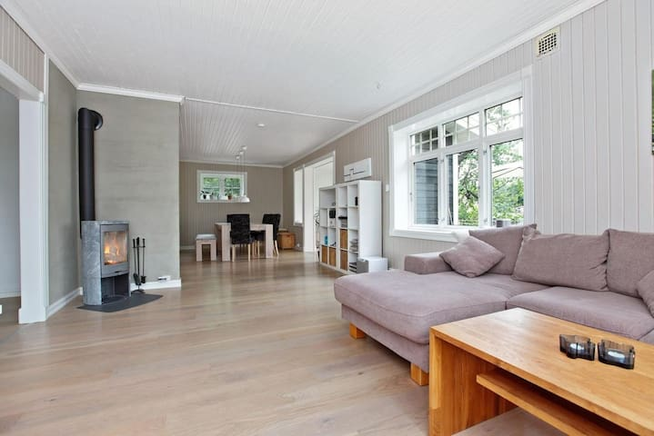 """Living room/dining room with 65"""" tv and a cosy fireplace."""
