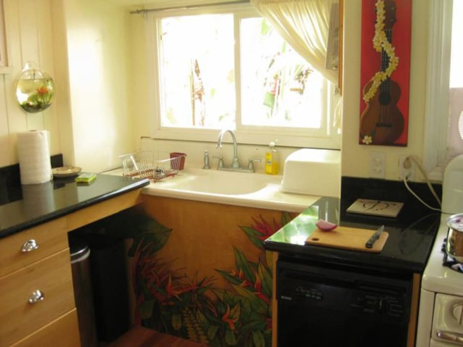 full kitchen with lots of counter space, dishwasher, gas stove, full size fridge.