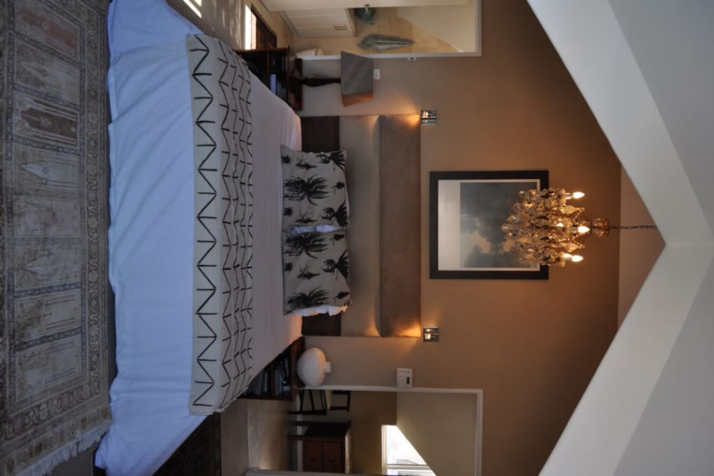 The main en-suite bedroom overlooks the city and Table Mountain.