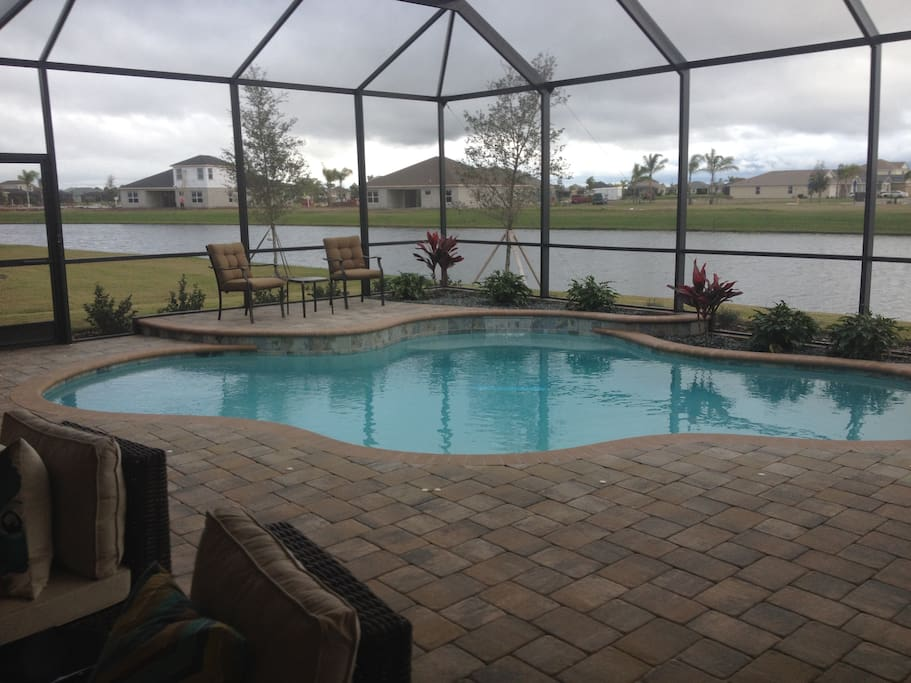 Swimming pool and lanai on the lake.