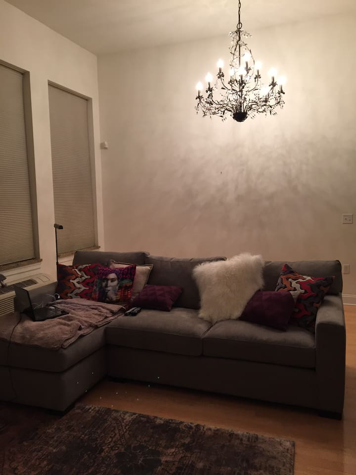 """large living room with chandelier and 55"""" SMART TV"""
