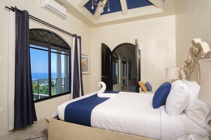 Bedroom Sidorma with ocean view and queen bed
