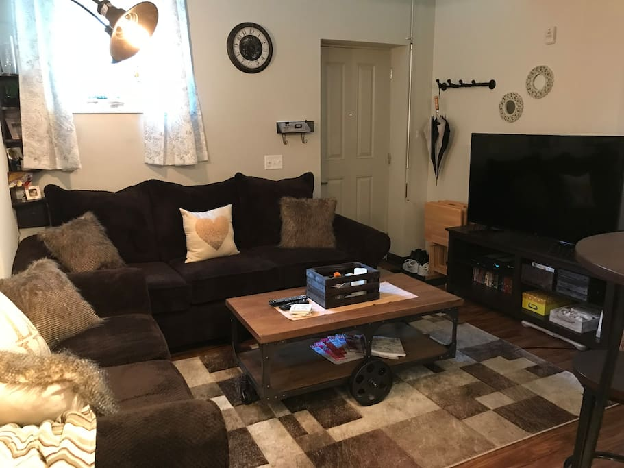"Living Room-Includes wi-if, home phone and cable. 55"" television, Wii, DVD player with access to all movies/games. Extra wide couch and loveseat can sleep an additional 2 comfortably."