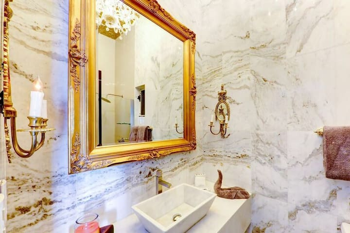 One of the 3 bathrooms ( marble elk over )