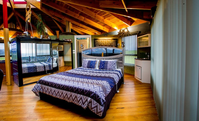 Upstairs Master bedroom with sky light to the night sky.