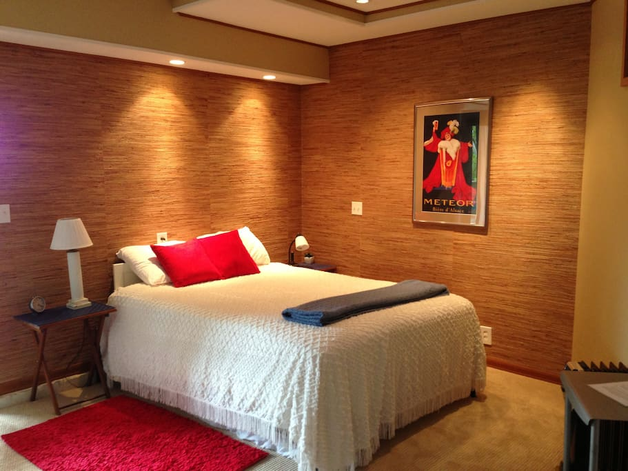 Queen bed, there is a full futon mattress stored under the bed that can be pulled out and used on the floor
