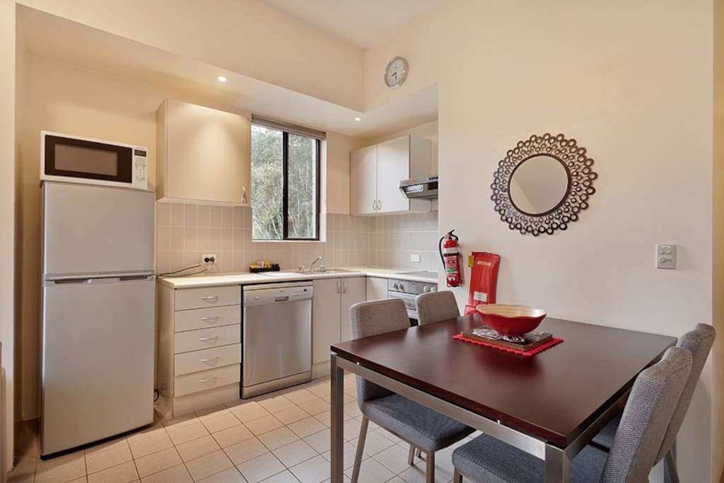 Full Kitchen and a comfy dining setting