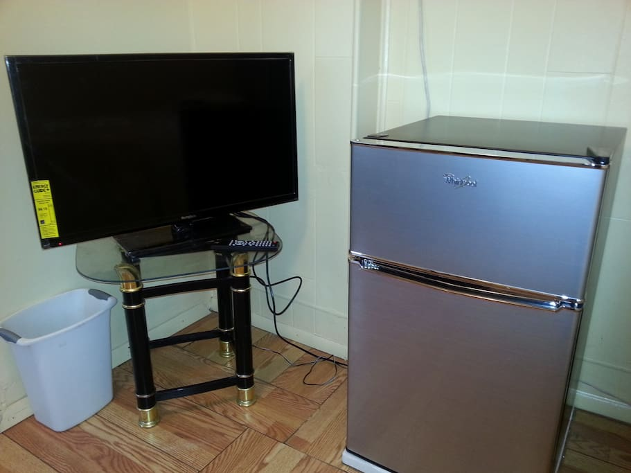Flat screen TV and fridge for your convenience.