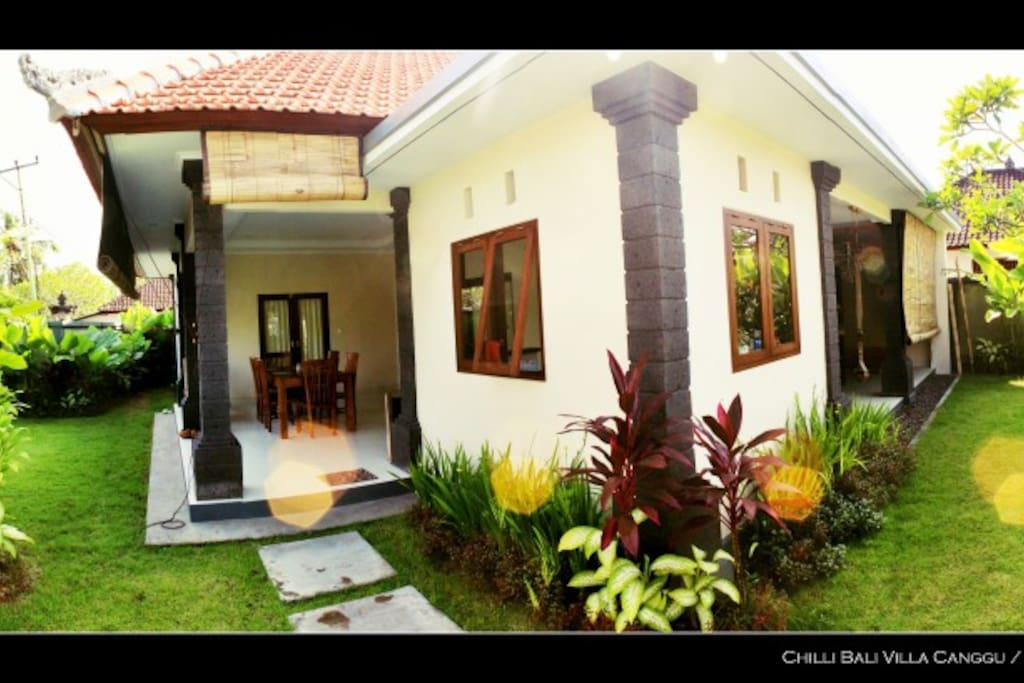 Front of the house with tropical spacious garden