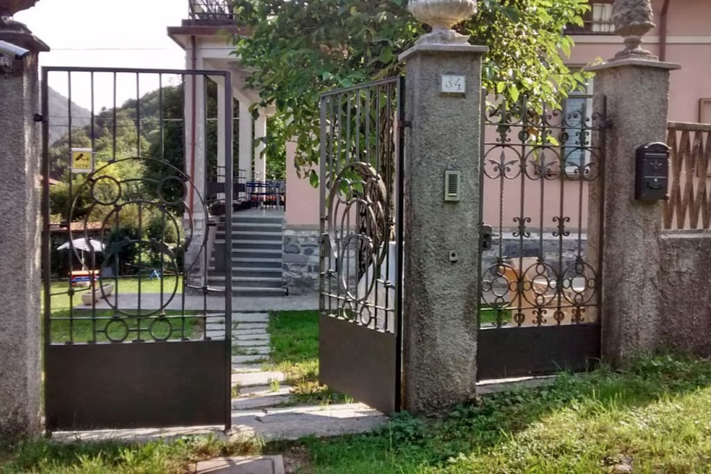 The stunning ancient iron gate: the main entrance to the villa.