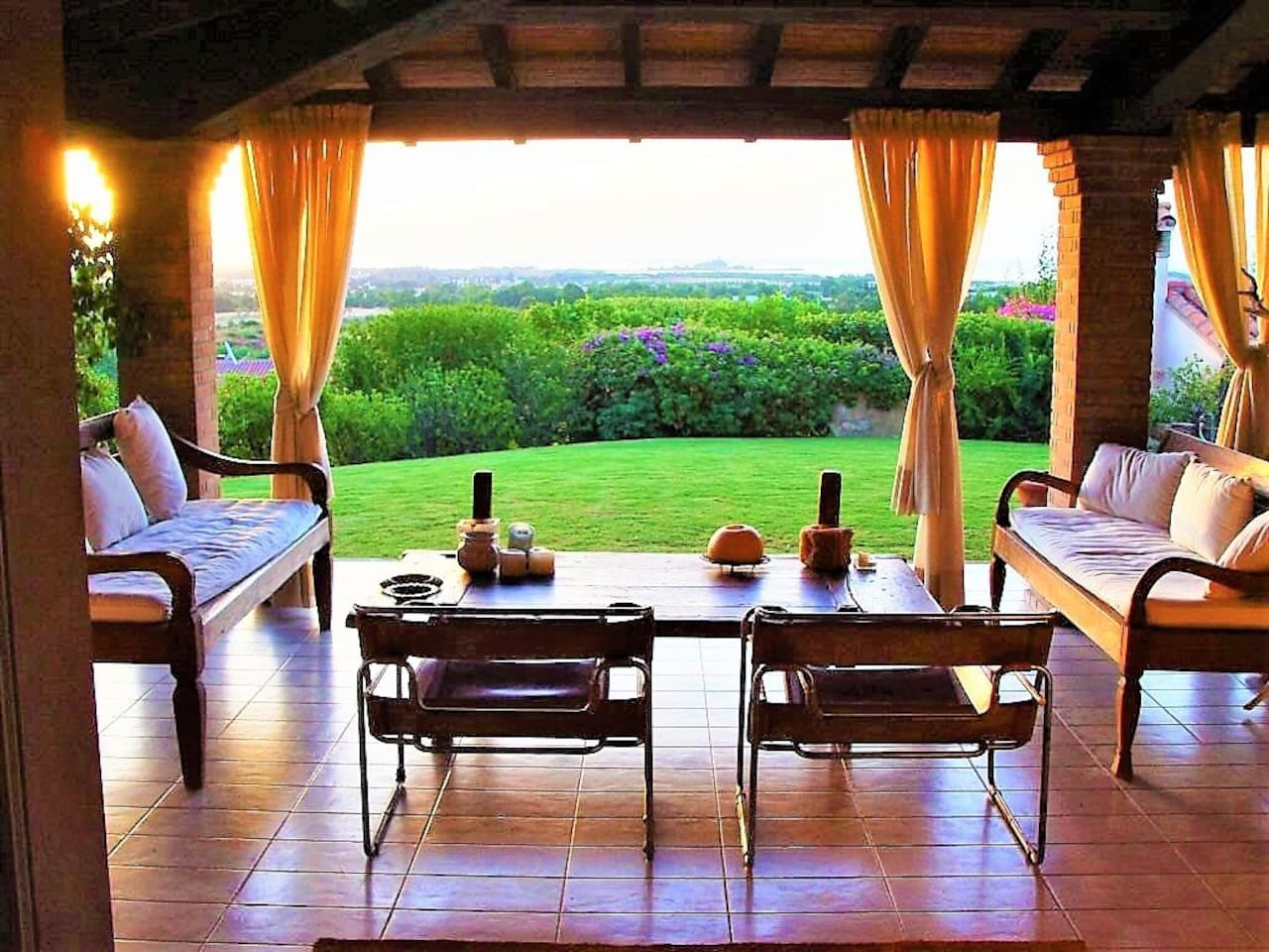 One of the many panoramic points of the house. This veranda has two benches and an old indian table to take a coffèe or relax with a book in front of the garden and the sea