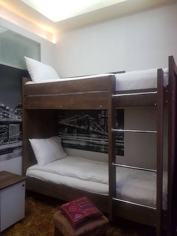 SMALL BAD ROOM BEDS & LOGO