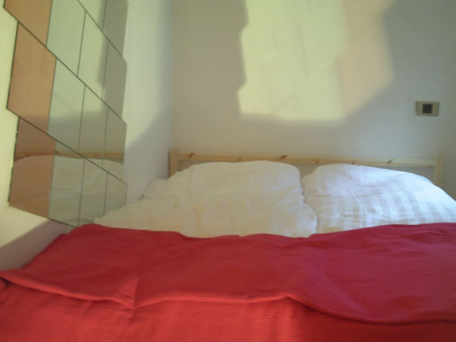 The double bed in the bedroom - a small room but cosy.