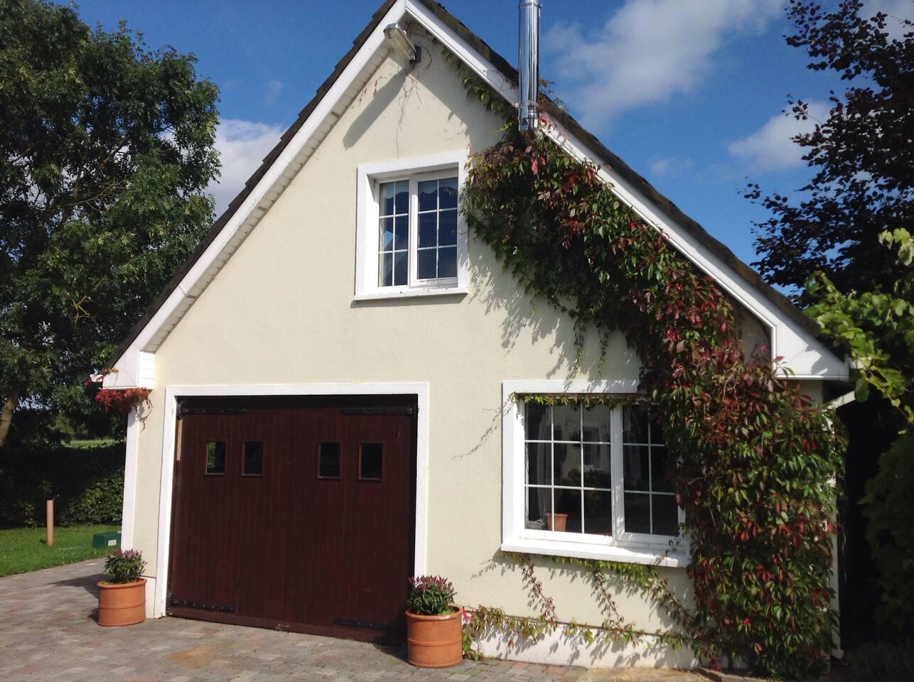 Outside, entrance at side