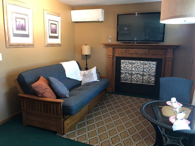 Couch can be made into a full-size bed. Decorative fireplace with the TV above it