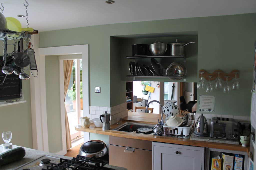 Open plan kitchen looking in dining room and garden