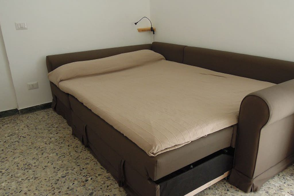 Sofa bed ready for sleeping. It can be quickly turned into an L-shaped sofa