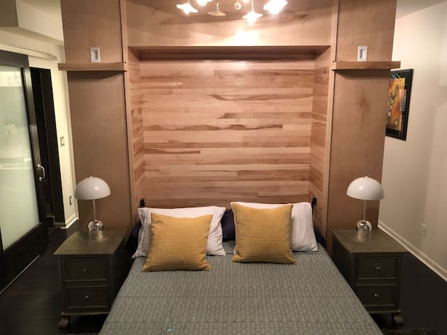 Bedroom with smart tv and Bluetooth speakers