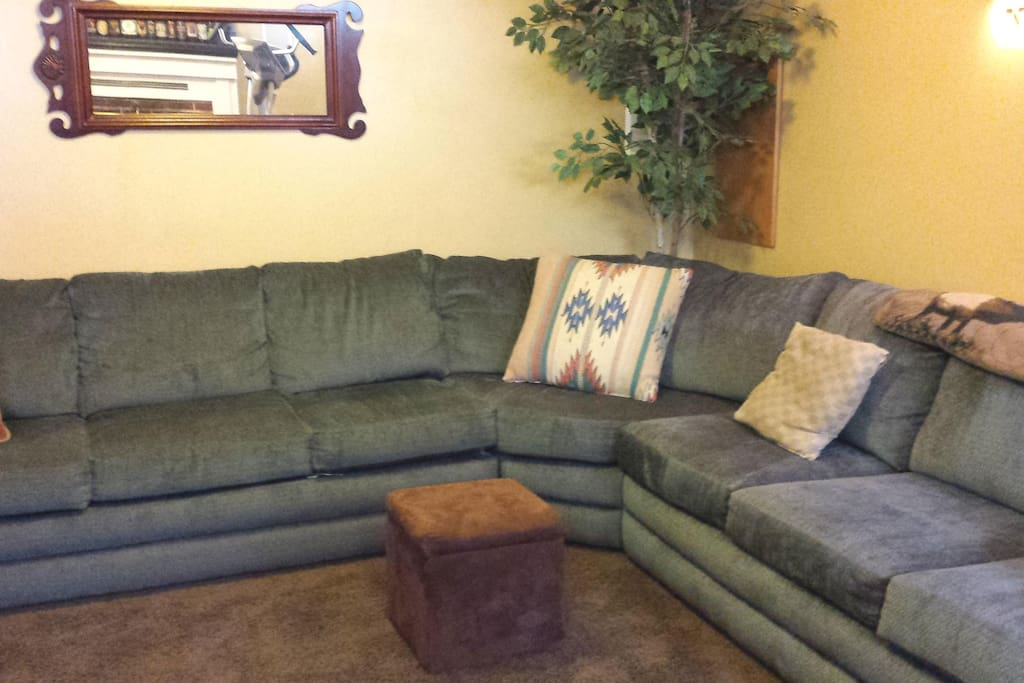 Very large, comfortable sectional couch - for watching TV or it can easily accommodate two adults for sleeping.