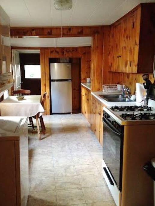 Kitchen, mudroom, and washer/dryer
