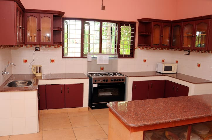 Kitchen with Kettle and Oven Top.