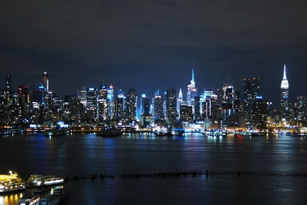 Night time view of the NYC right in front of the apartment .