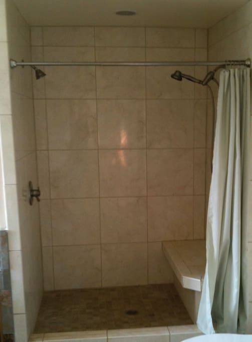 Large shower with duel shower heads.
