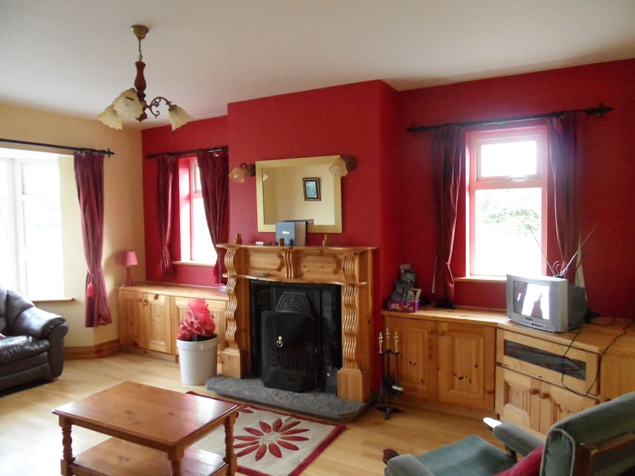 The sitting room complete with open fire