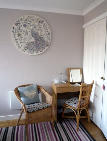 Seating area in your bedroom with fold down dressing table mirror