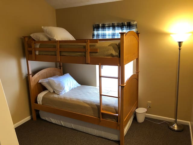 Third bedroom.  There is a bunk bed with a pull out mattress underneath. All of the twin mattresses in this room are adult sized mattresses.