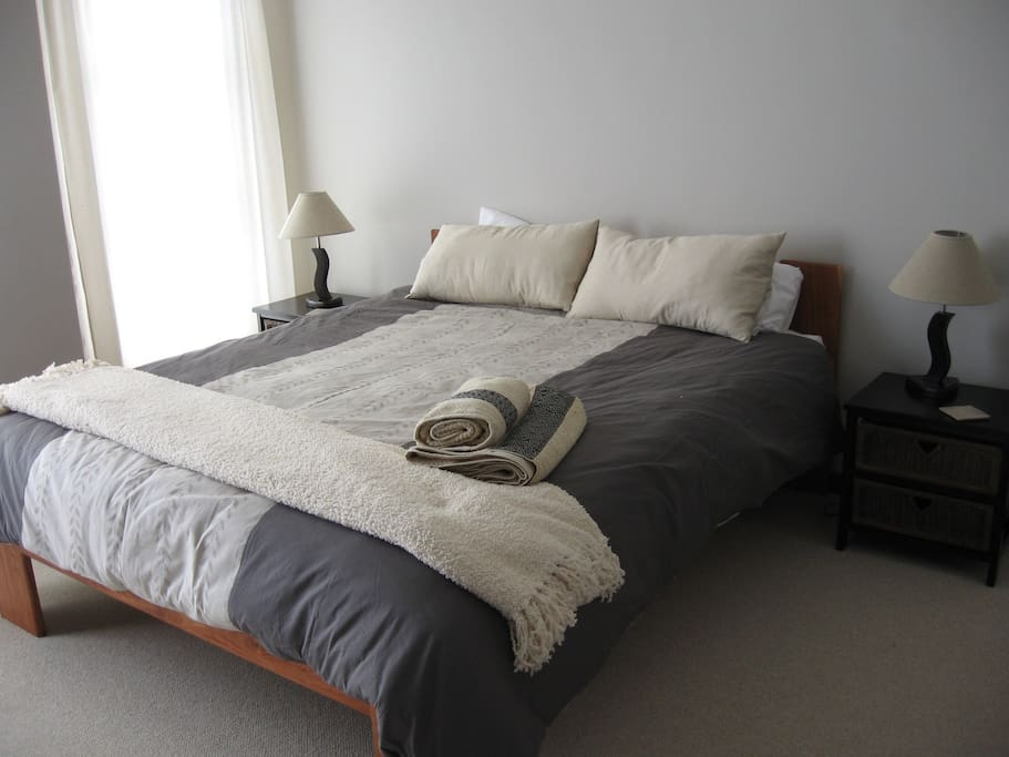 The main bedroom - queen bed with hand made linen. (Please note: we have a number of different sets, this may not always be on the bed, also note the curtains have been changed due to some rust damage, since the photo)