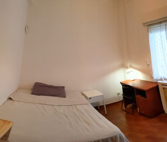 Private room, double bed  in a spacious apartment