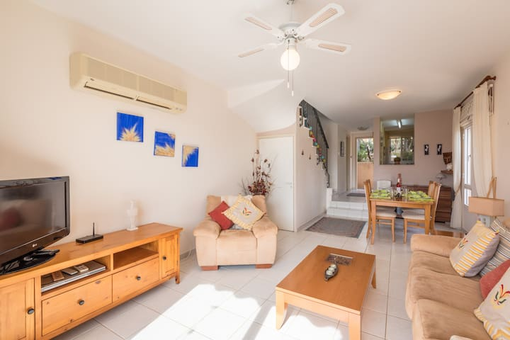 Comfortable bright air conditioned open plan living area