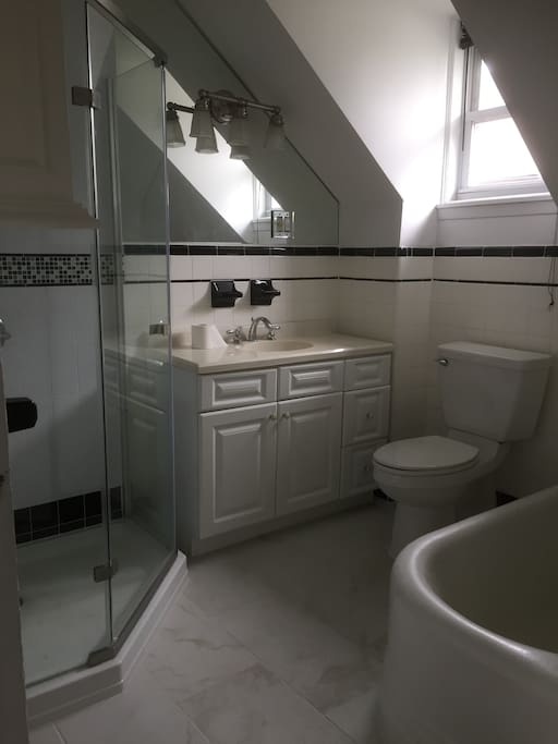 Large bathroom with shower and soaker tub.