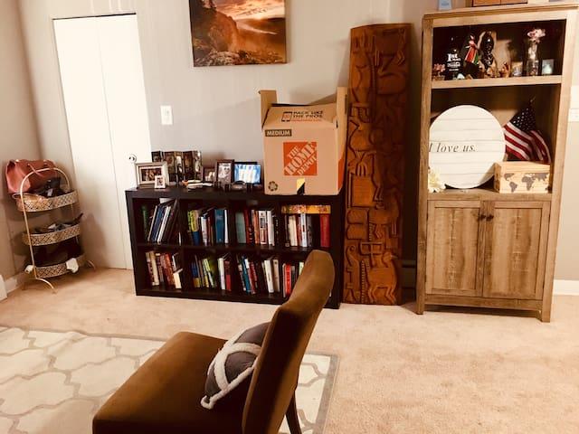 Living room filled with books for guests.