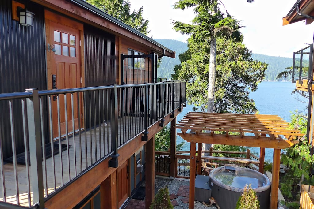 The 1 BR suite is on the lower level (ground level) with hot tub private to your suite only.