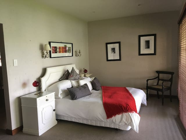 A Queen size bed with an on suite bathroom.