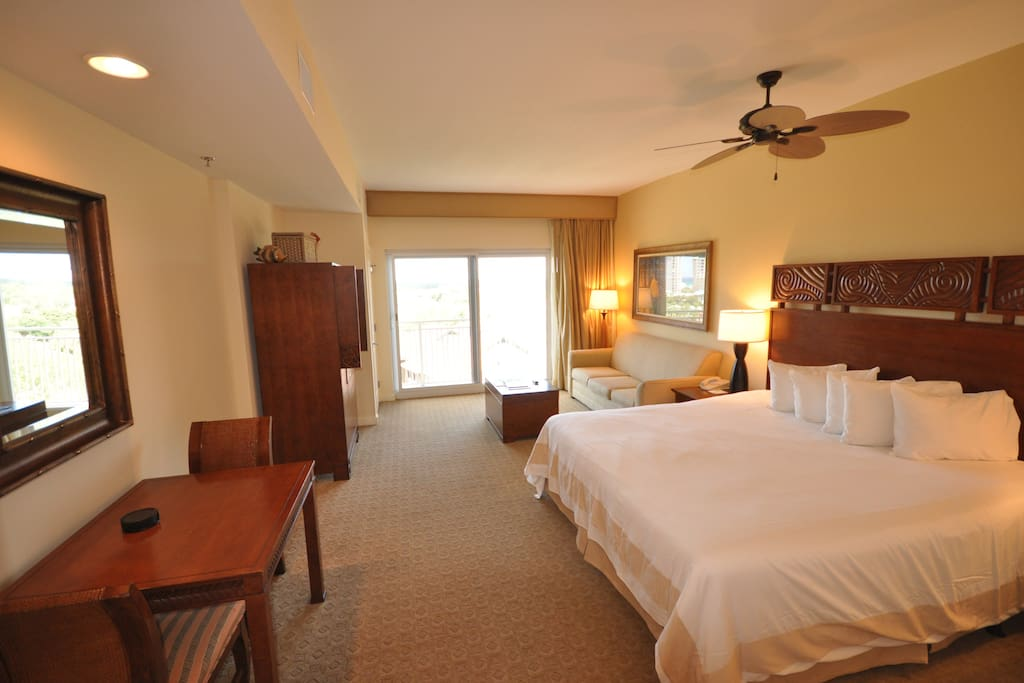 Comfortable king size bed overlooks to golf course lake and gulf waters.